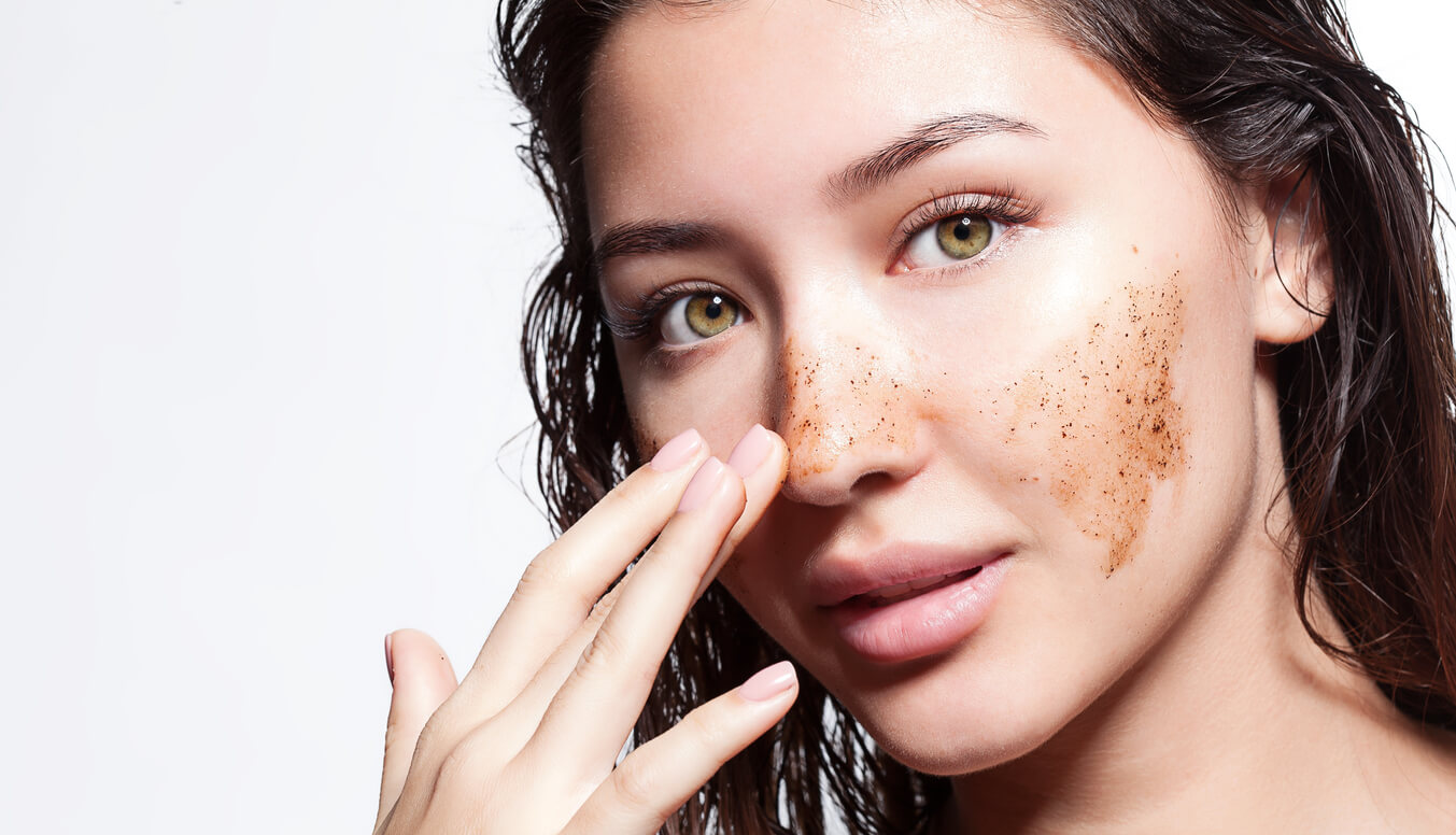 A woman with exfoliating cream on her face